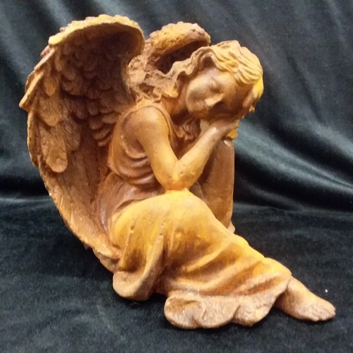 1018 - A cast iron statue of a sleeping angel 22cm high.(150)....