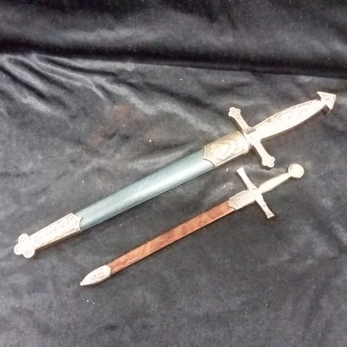 1266 - Two replica model swords.(209)....