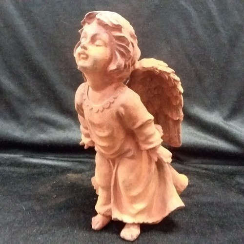 1051 - A cast iron statue of an angel blowing a kiss 23cm high.(143)....
