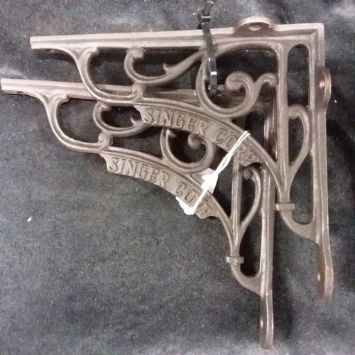 1390 - A pair of cast iron wall brackets.(134)....