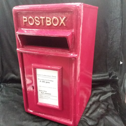 1074 - A cast iron red letter box with keys 43cm tall x 27cm deep.(49)....