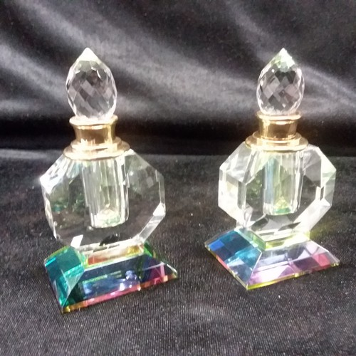 1276 - A pair of cut glass perfume bottles.(168)....