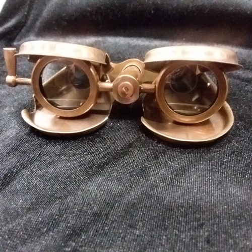 1286 - A pair of brass folding opera glasses.(111)....