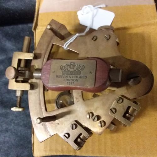 1285 - A miniature brass sextant.(112)....