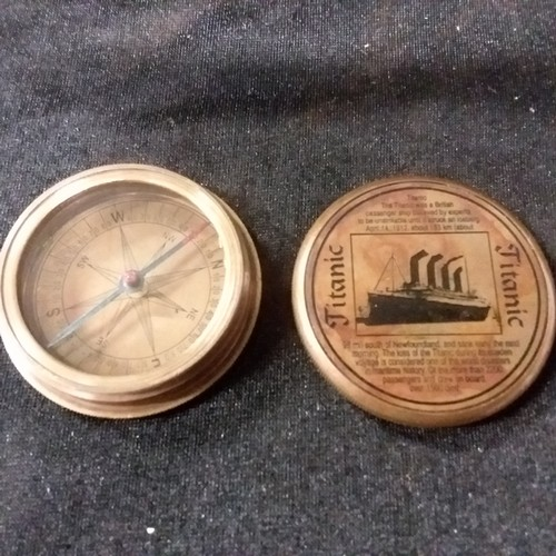 1290 - A replica Titanic pocket compass.(115)....