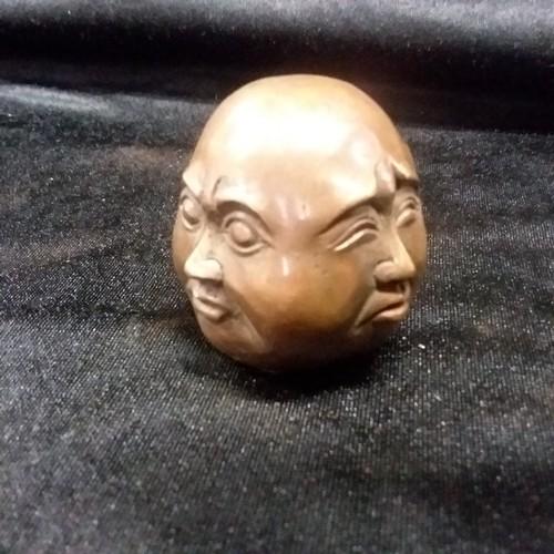 1292 - A four faced Buddha head.(107)....