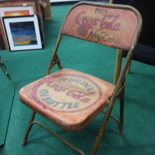 1371 - A painted folding chair with Coca-Cola motifs.(203)....