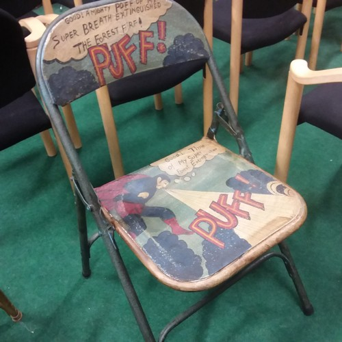 1372 - A painted folding chair with superheroes.(204)....