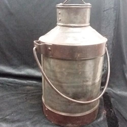 1173 - An old style milk churn.(190)....