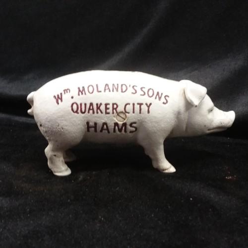 1043 - A cast iron piggy bank.(141)....