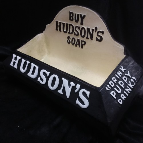 1053 - A cast iron Hudson's soap dog's water bowl.(132)....