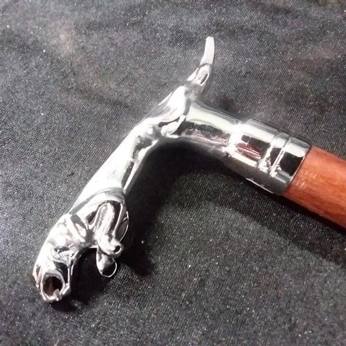1296 - A walking stick with a Jaguar handle.(178)....