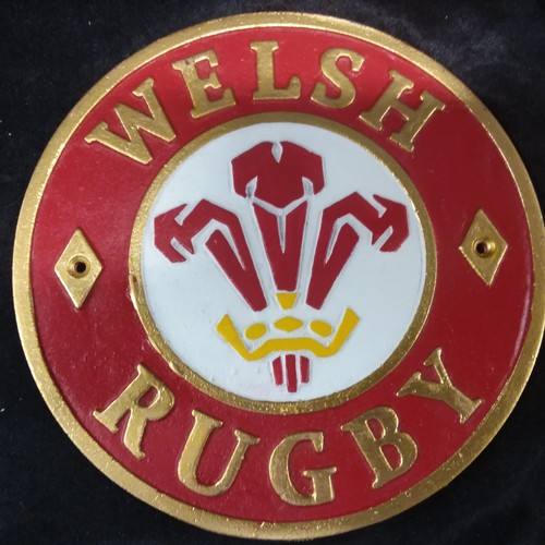 1130 - A cast iron Welsh rugby plaque.(225)....
