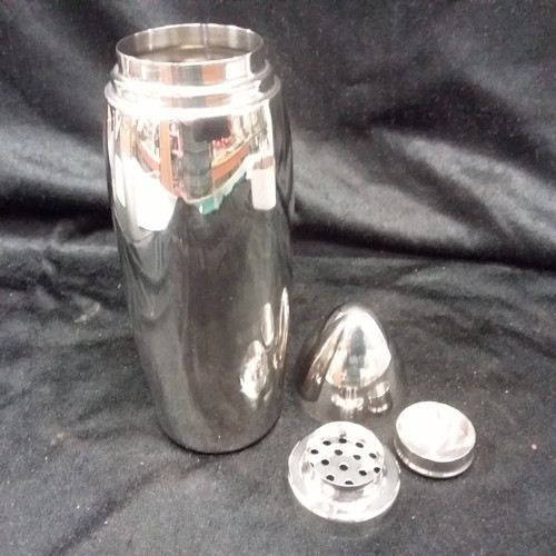 1277 - A bomb shaped stainless cocktail shaker.(184)....