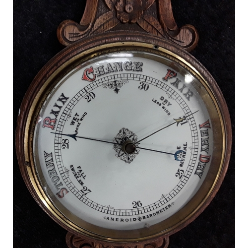 1113 - Aneroid oak banjo barometer and thermometer....