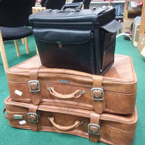 1099 - Two vintage suitcases together with a pilot's holdall....