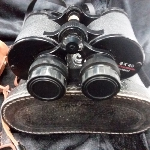 1157 - Two pairs of binoculars, Kershaw Monarch 12 12x40 and a 8x40 with carry cases....