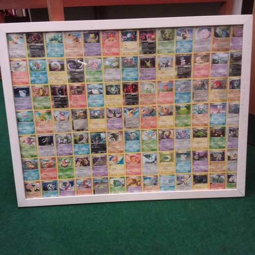 1233 - A large framed collection of Pokemon collectors cards....