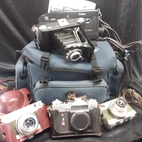 1134 - A Cannon E300 camcorder together with four various cameras....