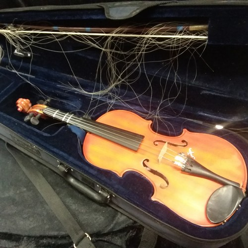 1128 - A Chinese violin in its case....