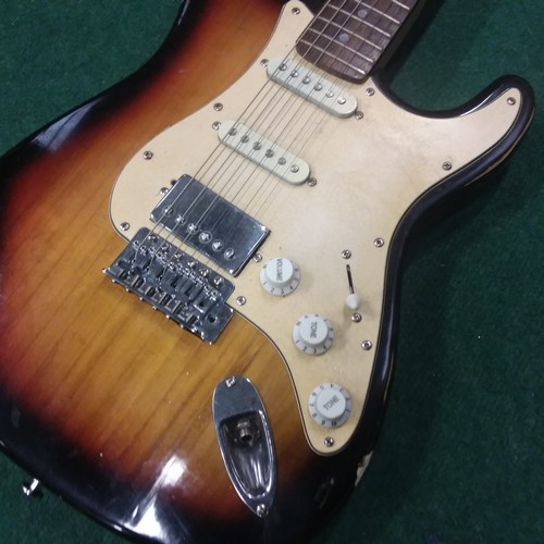 1078 - A Squier Strat by Fender electric guitar....