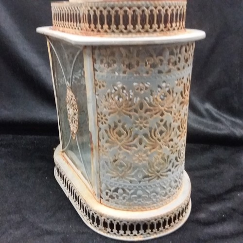 1005 - A metal garden lantern....