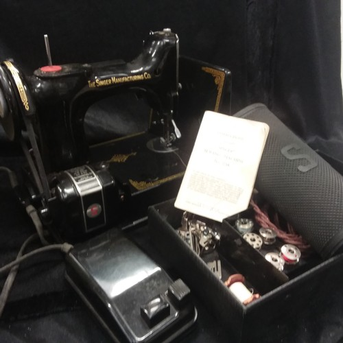 1112 - A Singer no.221k sewing machine in its carry box complete with a bobbin tray....