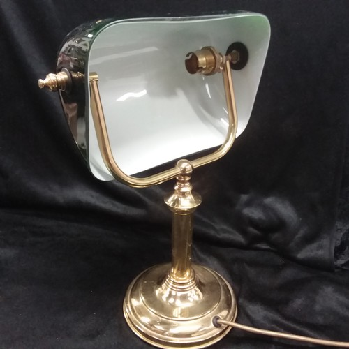 1115 - A brass office lamp with a green glass shade....
