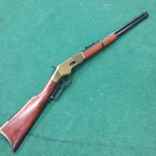 1254 - A replica Winchester repeating rifle with lever action....