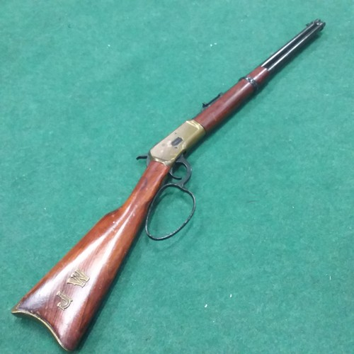 1255 - A replica Winchester repeating rifle with lever action....