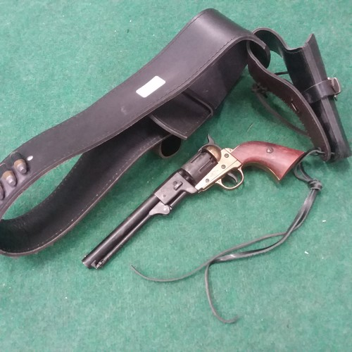 1254A - A replica Colt pistol with leather holster and bullets....