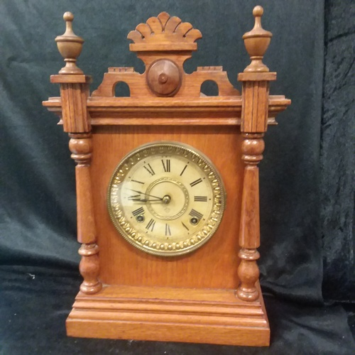 1013 - An Ansonia Troy oak mantle clock with pendulum and key circa 1903 made by Ansonia clock company N Y....