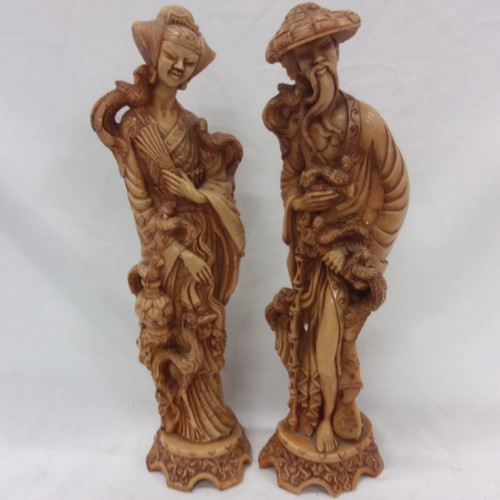 1031 - A pair of modern resin oriental figurines....