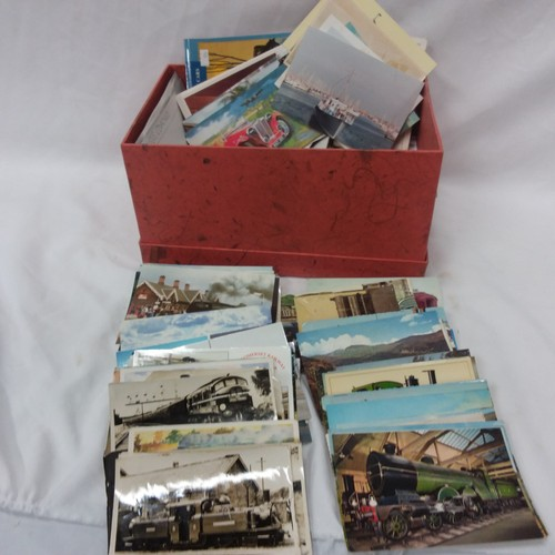 1033 - A box of mixed postcards....