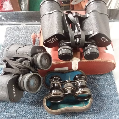 1047 - Two pairs of binoculars (one cased) together with a cased pair of opera glasses....