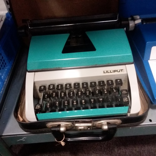 1072 - A portable Lilliput typewriter together with a Petite super international typewriter....