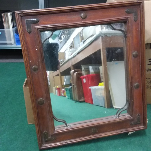 1079 - A hardwood and metal strapped wall mirror....