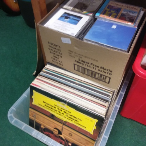 1087 - A box of classical music LPs together with a box of classical CDs....