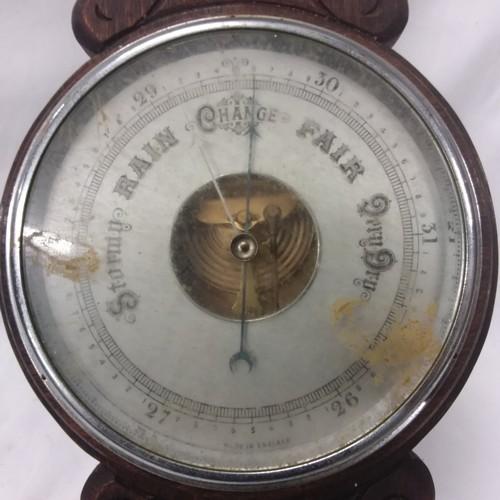 1117 - An oak cased wall barometer....