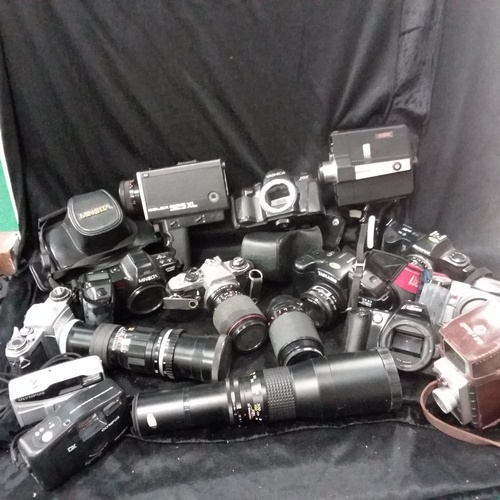 1121 - A box of various cameras and lenses....