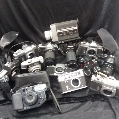 1136 - A box of various cameras and lenses...