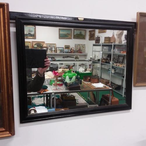 1140 - A wooden framed hall mirror....
