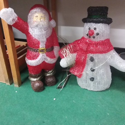 1163 - Two outdoor Xmas decorations - a Snowman and a Father Christmas....