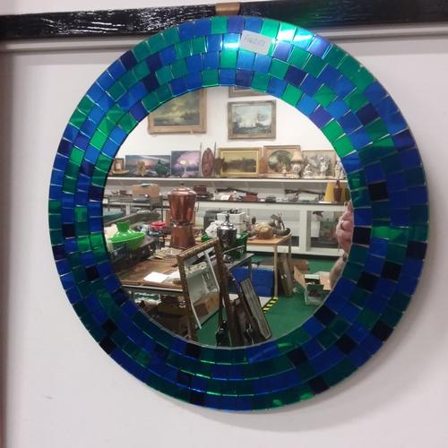 1167 - A circular tiled mirror....