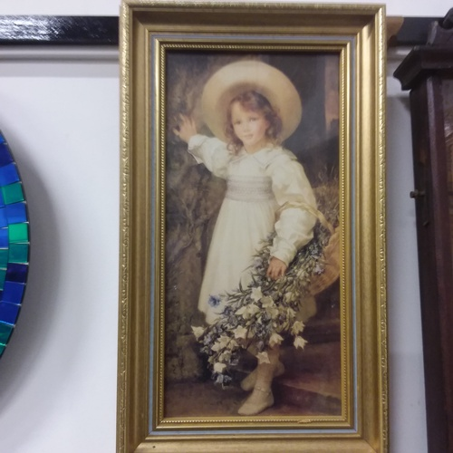 1168 - A framed print of a young girl collecting flowers....