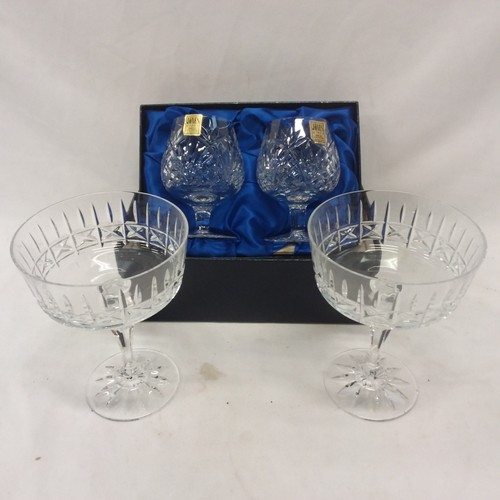 1195 - A boxed set of two Jones crystal brandy glasses together with a pair of Galway glass sundae dishes....