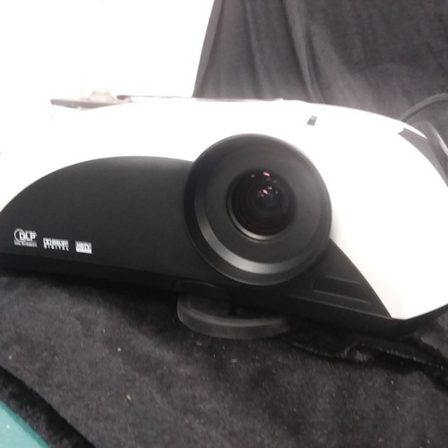 1209 - An Optoma Movie Time digital DVD projector with carry case and booklet....
