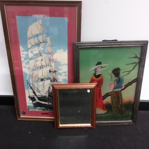 1256 - A framed and glazed ship tapestry together with an oriental framed picture and a small mirror....