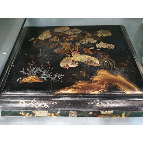 1213 - A black lacquered oriental jewellery box....