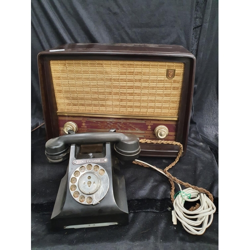 1215 - A vintage Phillips bakelite radio together with a vintage bakelite dial phone....